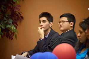Pro speakers Anthony Marquez and Ryan Chiu furrow their brows as the opposing team takes the podium