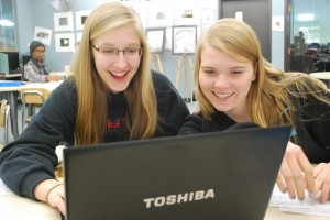 Becca (L) and Marissa (R) mull over notes from their 'Humans of IMSA' meeting.