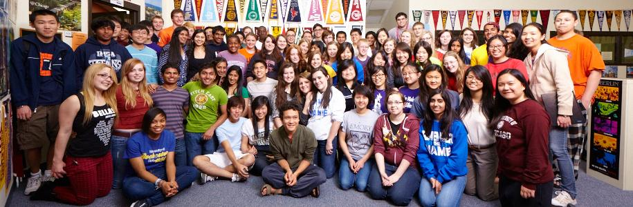 Members of the graduated Class of 2013 stand together in the CAC office library